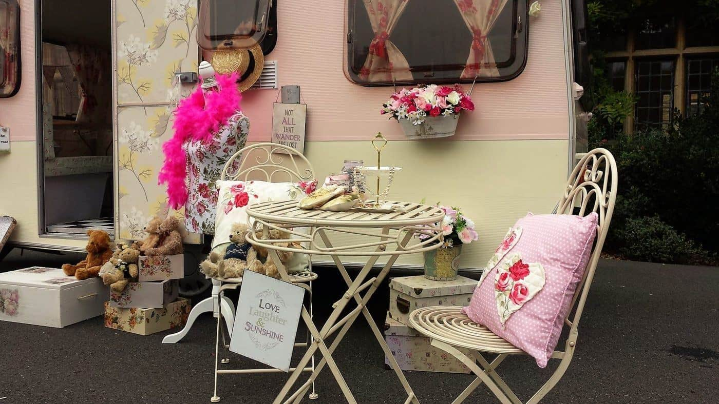 outside table vintage caravan photo booth hire