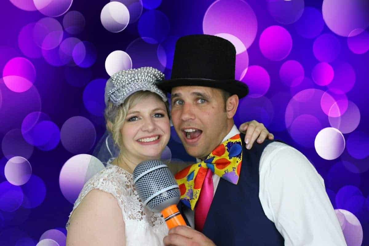 bride and groom in the wedding photo booth hire