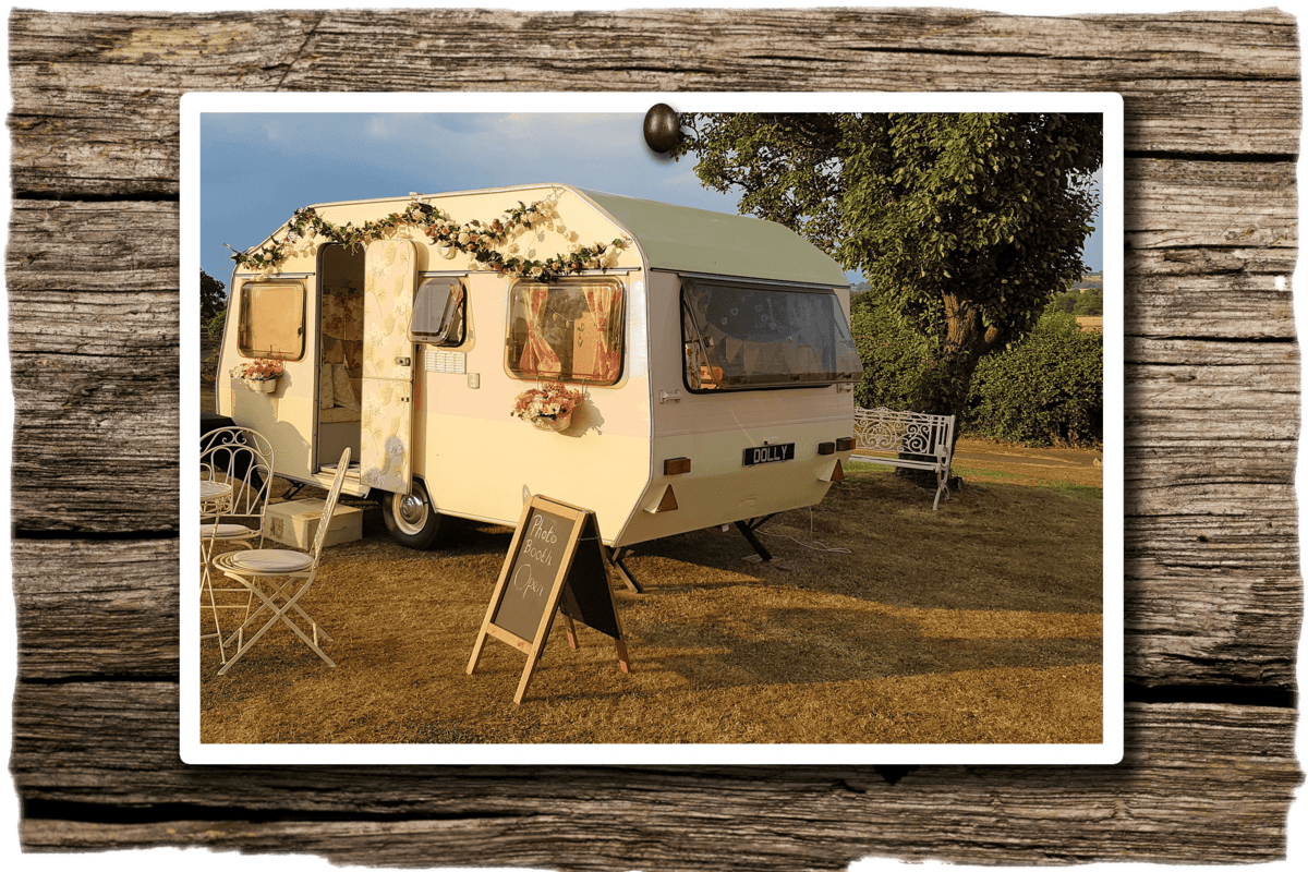 picture of vintage caravan photo booth with wooden background